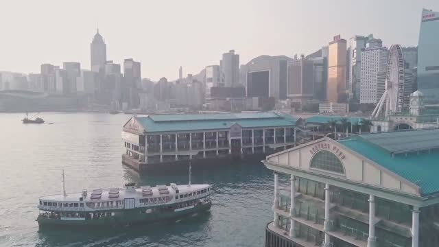 stockvideo's en b-roll-footage met hong kong star ferry central terminal and harbour front. aerial drone view - star ferry