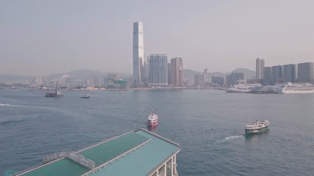 stockvideo's en b-roll-footage met hong kong star ferry, central terminal and harbour front. aerial drone view - star ferry