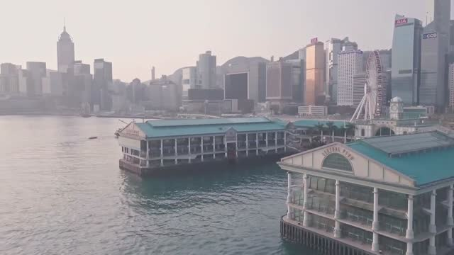 stockvideo's en b-roll-footage met hong kong star ferry central terminal and harbour front in downtown city centre. aerial drone view - star ferry