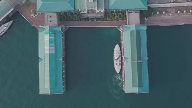 stockvideo's en b-roll-footage met hong kong star ferry, central terminal and harbour front. top down aerial drone view - star ferry