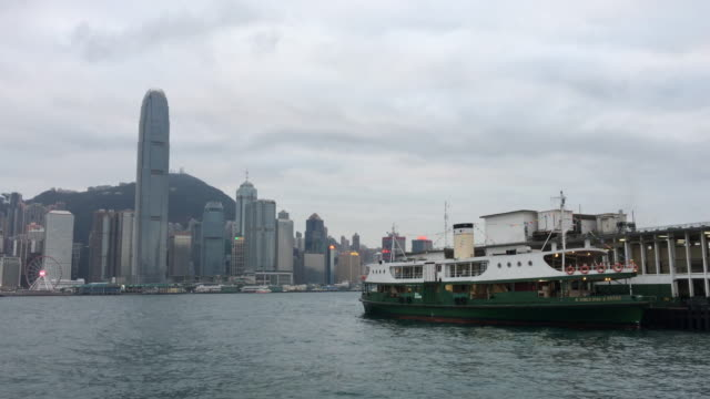 hong kong star ferry floating at tst tsim sha tsui pier victoria harbour - star ferry stock videos & royalty-free footage