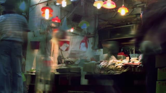 time lapse - hong kong street fish market - fish market stock videos & royalty-free footage