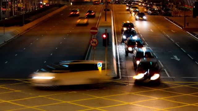 hong kong traffic night timelapse - corner stock videos & royalty-free footage