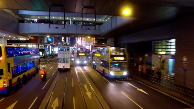 hong kong tramway point of view in central at night - hong kong island stock videos & royalty-free footage