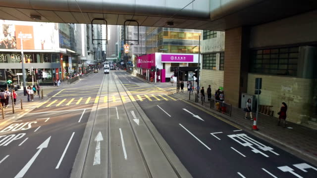 hong kong tramway point of view in central - hong kong island stock videos & royalty-free footage