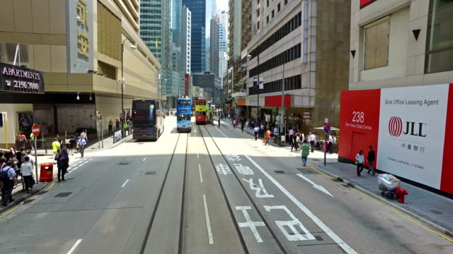 hong kong tramway point of view in central - hong kong stock-videos und b-roll-filmmaterial