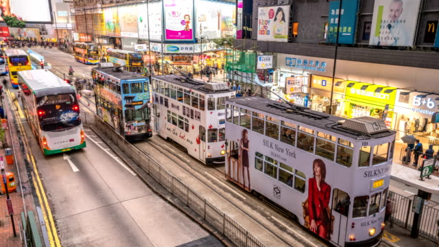 4k tl hong kong tramways at twilight. - bus billboard stock videos & royalty-free footage