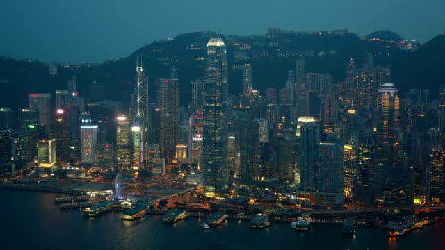 hong kong, tsim sha tsui ifc and passenger terminal in hong kong island, night view - tsim sha tsui stock videos & royalty-free footage