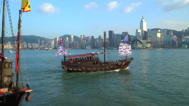 hong kong, victoria harbour and skyline - victoria harbour hong kong stock videos and b-roll footage