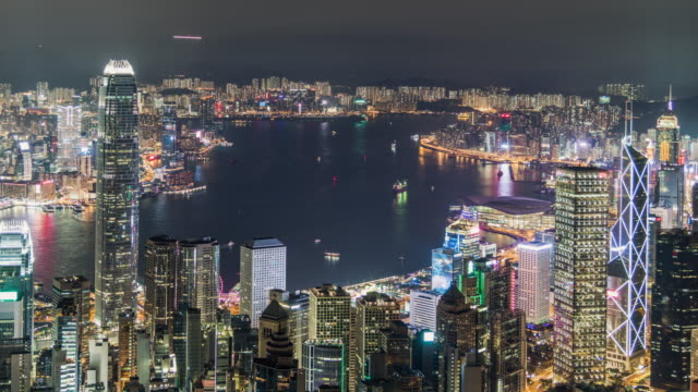 t/l tu hong kong victoria harbour at night - westernisation stock videos & royalty-free footage