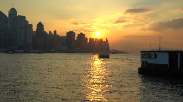 hong kong, victoria harbour at sunset - victoria harbour hong kong stock videos and b-roll footage