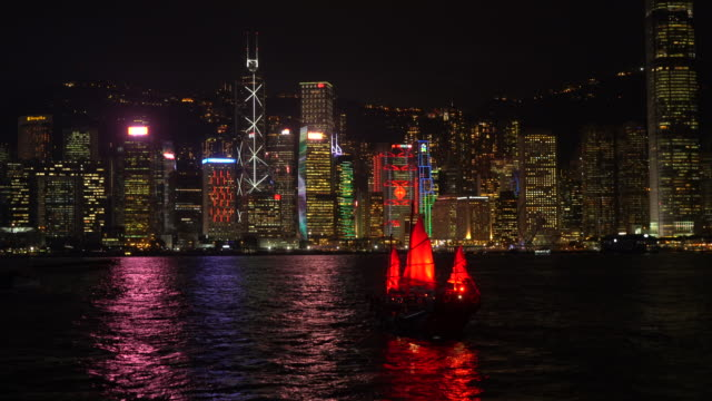 hong kong, victoria harbour by night - victoria harbour hong kong stock videos & royalty-free footage