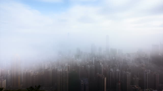T/L WS Hong Kong Victoria Harbour in clouds and mist / Hong Kong, China
