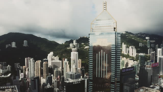 hong kong viewed from the drone with city skyline of crowded skyscrapers. - central plaza hong kong stock videos & royalty-free footage
