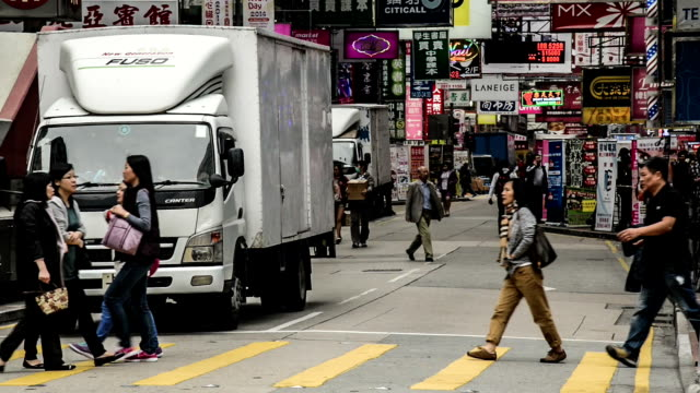 hong kong,china-nov 13,2014: the traffic and pedestrians in the downtown of hong kong,china - agricultural fair stock videos and b-roll footage