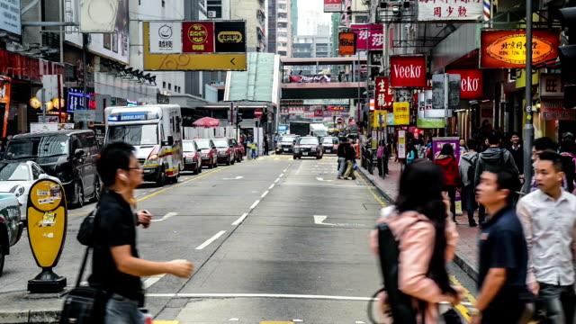 Hong Kong,China-Nov 13,2014: The traffic and pedestrians in the downtown of Kowloon in Hong Kong, China