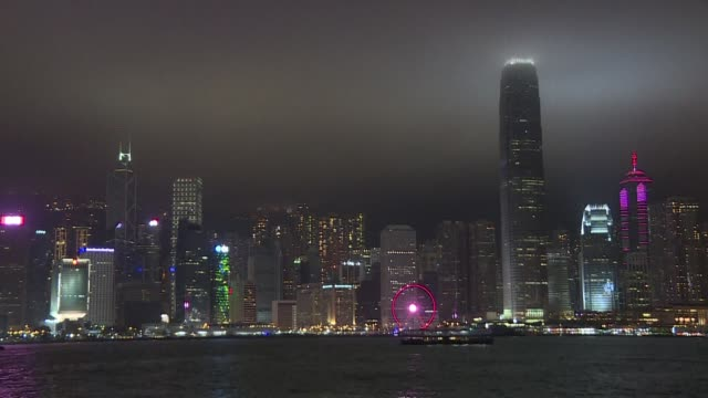 hong kong's iconic skyline along the victoria harbour plunges into darkness for an hour as part of a global campaign to raise awareness about climate... - climate icon stock videos & royalty-free footage