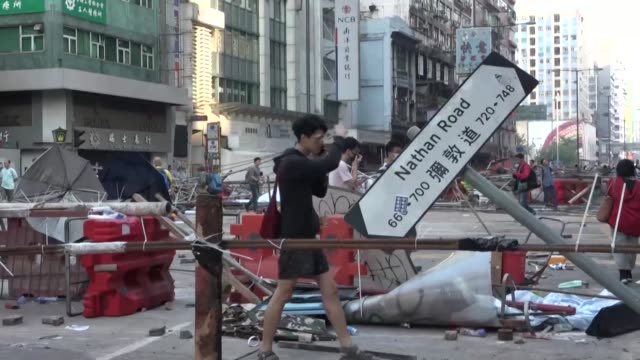 vídeos de stock, filmes e b-roll de hong kong's major shopping street nathan road is strewn with rubble and barricades following tuesday's fierce protests - major road