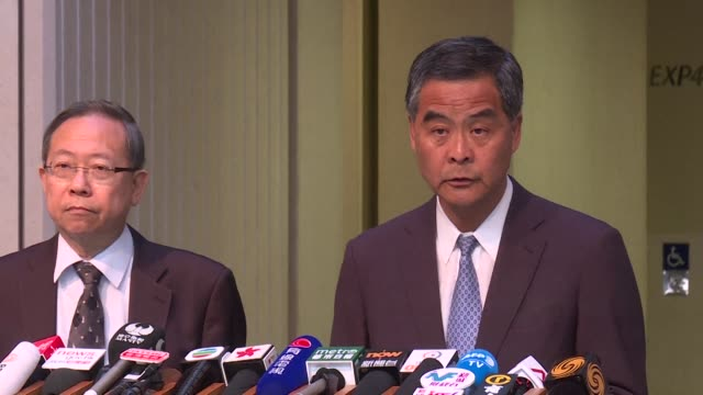 hong kongs top official leung chun ying says one country two systems is not under threat after bookseller lam wing kees likened his detention in... - bookseller stock videos and b-roll footage