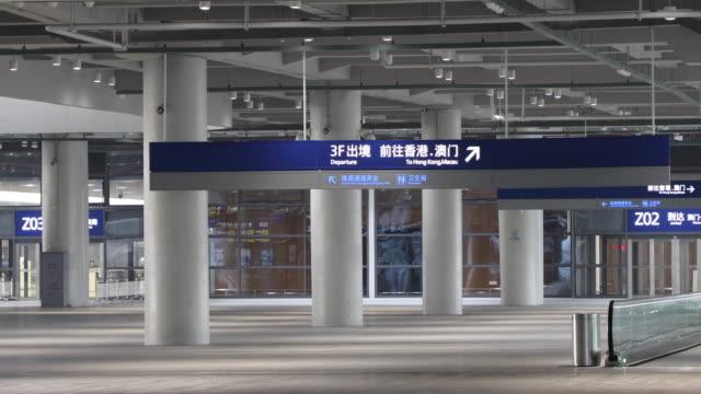 hong kong-zhuhai-macau bridge,zhuhai port,china - バス停留所点の映像素材/bロール