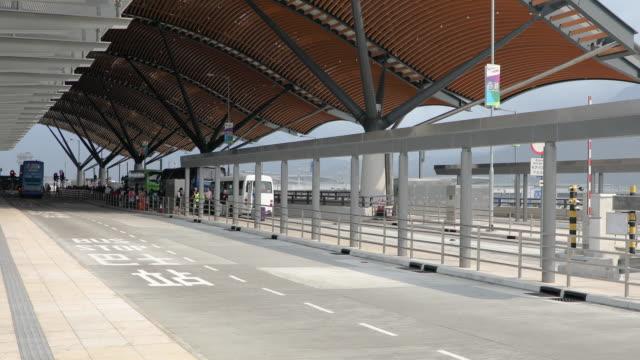 hong kong-zhuhai-macau cross-border expressway,hongkong port,china - バス停留所点の映像素材/bロール