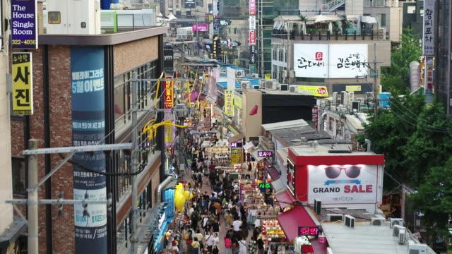 hongdae (hongik university street) / seogyo-dong, mapo-gu, seoul, south korea - shopaholic stock videos & royalty-free footage
