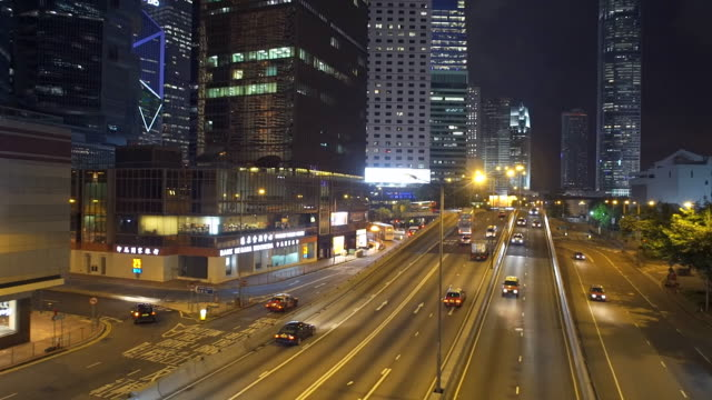 Hongkok traffic through modern city at night ,Panning
