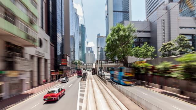 vídeos de stock, filmes e b-roll de t/l ws hongkong central building/street drifting view - ponto de vista de bonde