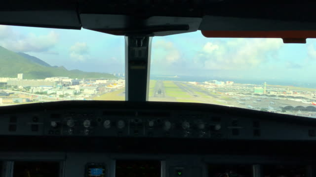 hongkong intl. airport, approach and landing (pov shot) - landing touching down stock videos & royalty-free footage