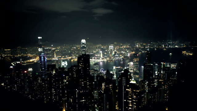 hongkong skyline at night with laser show - victoria peak stock videos & royalty-free footage