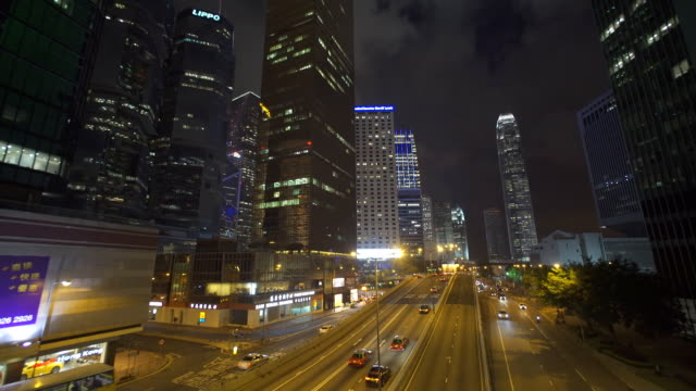 hongkong traffic through at night,time lapse - hsbc main building stock videos and b-roll footage