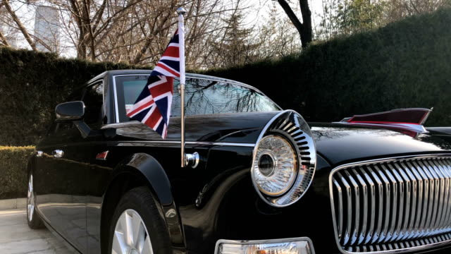 A Hongqi or 'Red Flag' car waits outside the British Embassy on February 1 in Beijing China Theresa May who is on a three day visit to China will...