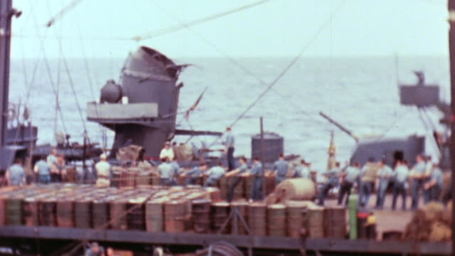 vidéos et rushes de honolulu crew helping uss helena survivors onto deck survivors being hauled from ship to ship via pulleys - marin