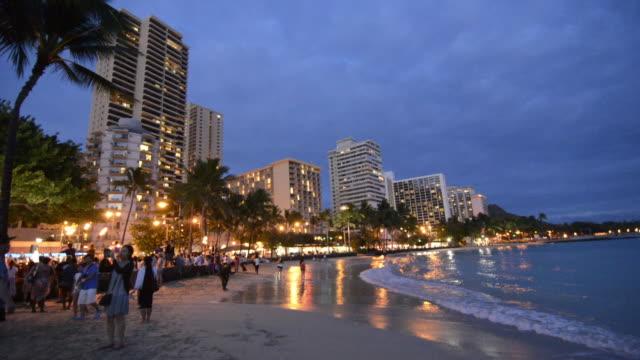 honolulu hawaii oahu waikiki beach night time with hotels and beach at twilight - honolulu stock videos and b-roll footage