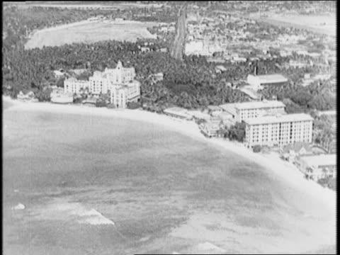 vídeos y material grabado en eventos de stock de honolulu hours after japanese attacks pearl harbor / aerials honolulu / hawaiian people around city and temple. - 1941