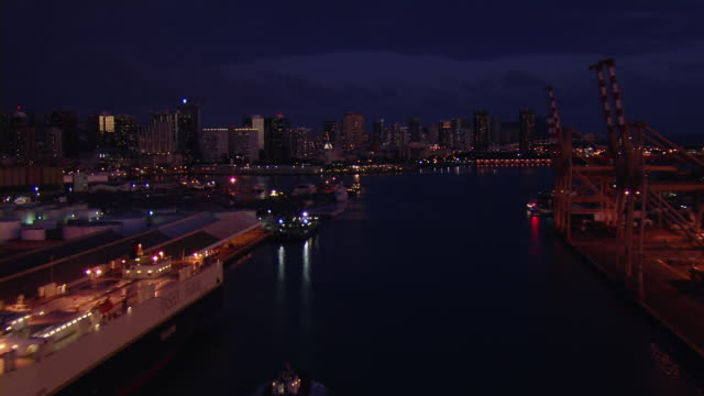 honolulu shipping yard and skyscrapers at night. - oahu stock videos & royalty-free footage