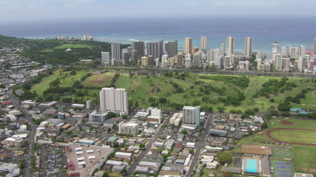 WS AERIAL Honolulu skyline, sea in background / Hawaii, United States