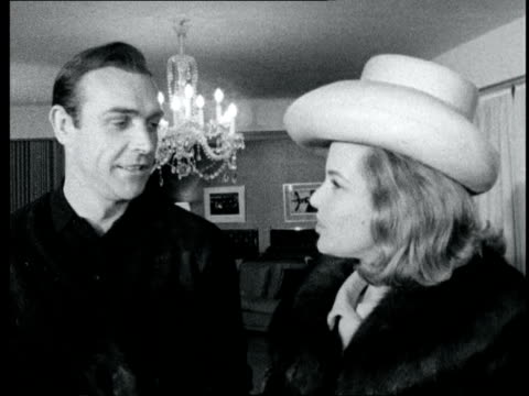 honor blackman meets sean connery; england: pinewood: sean connery and honor blackman kiss - she presents him with the variety club of great britain... - sean connery stock videos & royalty-free footage