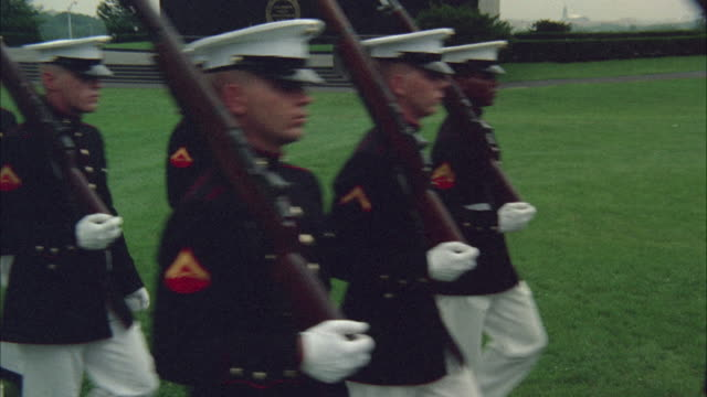 1967 MS TU WS Honor guard of marines marching in front of war memorial