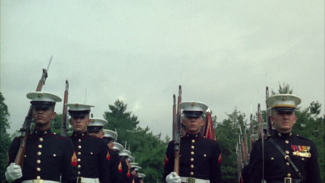 1967 MS LA Honor guard of marines marching through lawn