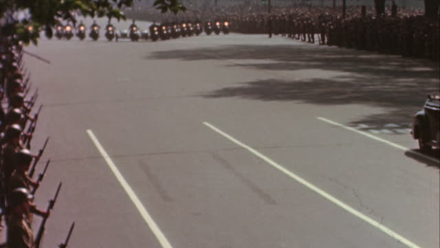 Honor guard of soldiers waiting for Roosevelt's funeral procession motorcade of motorcycle police with sidecars Jeep with soldiers and Admiral King /...