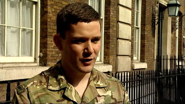 honours handed out for acts of gallantry unnamed soldier interview sot going well so far found out on tuesday massive shock to me and my wife and dad... - wife carrying stock videos and b-roll footage