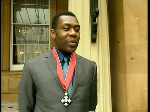 stockvideo's en b-roll-footage met honours lenny henry recieves cbe buckingham palace cbs held by henry pull out as posing with dawn french lenny henry interview sot she was kind / she... - lenny henry