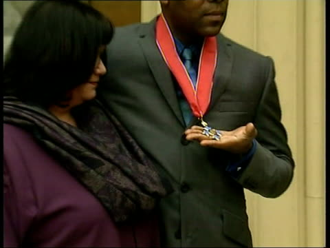honours - lenny henry recieves cbe; close-up of the medal pull out: lms henry posing with french - lenny henry stock videos & royalty-free footage