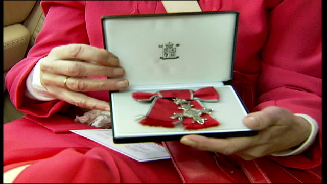 lollypop lady stella muncaster receives mbe buckingham palace muncaster showing mbe cross in box **muncaster interview overlaid over following... - lollypop lady stella muncaster stock videos & royalty-free footage
