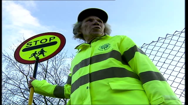 lollypop lady stella muncaster receives mbe west drayton ext muncaster holding lollypop stop sign zoom - lollypop lady stella muncaster stock videos & royalty-free footage