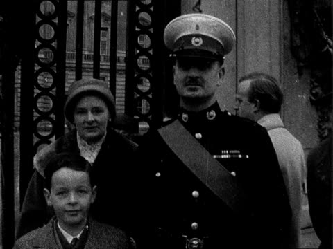 recipients of honours outside buckingham palace england london buckingham palace ext flight lieutenant griffiths and family along outside buckingham... - order of the british empire stock videos and b-roll footage