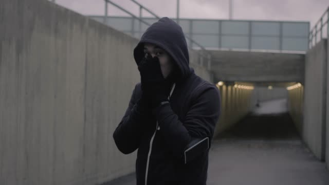 hooded asian man running in the tunnel - hooded top stock videos & royalty-free footage