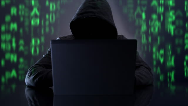 hooded hacker. cyber crime wth code. - hooded top stock videos & royalty-free footage