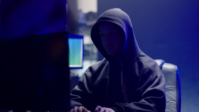 hooded hacker working on computer - bosnia and hercegovina stock videos & royalty-free footage
